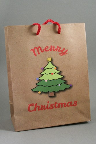 Merry Christmas with Christmas Tree Brown Gift Bag. Red Corded Handles.Size Approx 23cm x 18cm x 9cm.