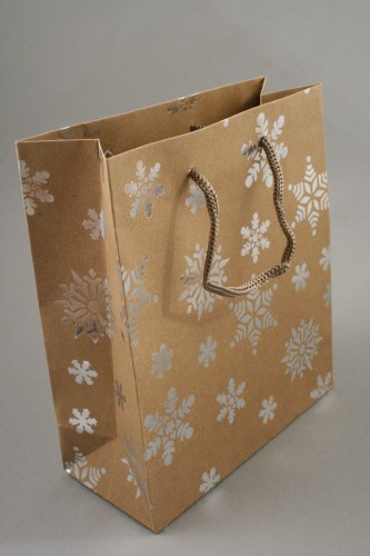 Natural Brown Kraft Paper Gift Bag with Silver Foil Snowflake Print and Brown Corded Handles. Size Approx 21cm x 18cm x 8cm.